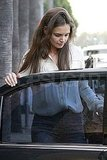 Katie Holmes heads home to Suri and Tom Cruise.