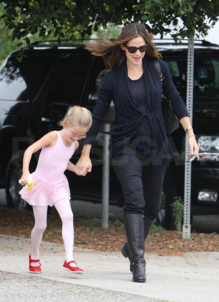 Violet Affleck holds hands with Jennifer Garner.