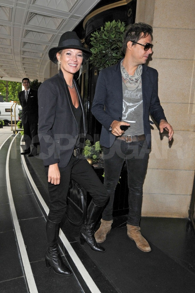 Kate Moss smiles with husband Jamie Hince.