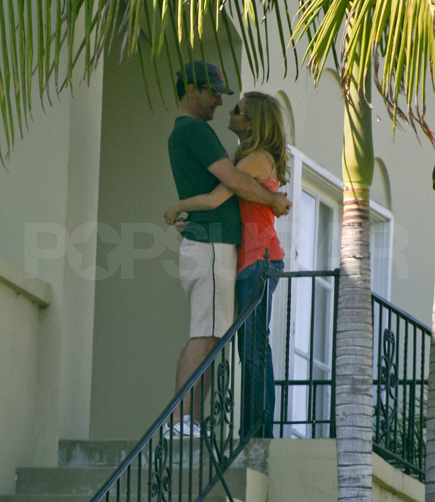 Jon Hamm and Jennifer Westfeldt hugging.