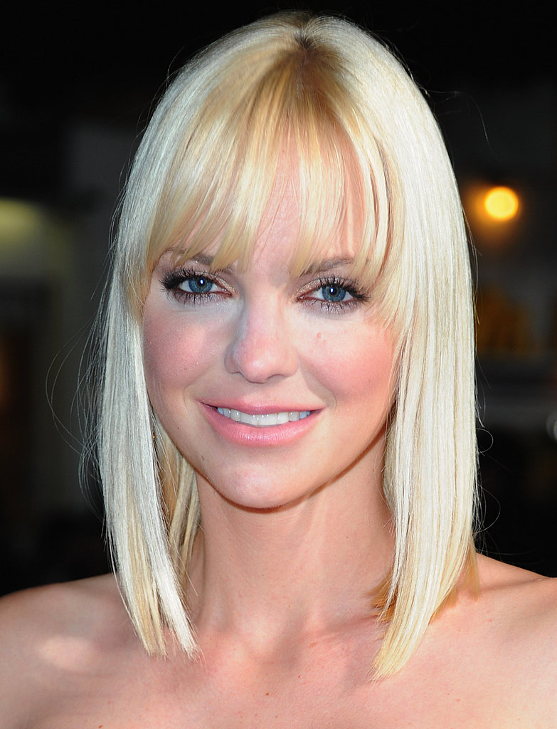Anna Faris smiles on the red carpet.