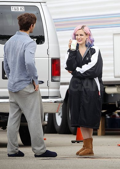 Alex chatted with costar Riley Keough during a break.