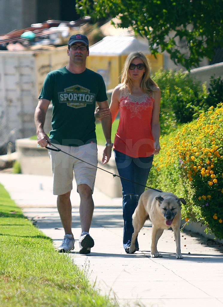 Jon Hamm and Jennifer Westfeldt walk their dog.