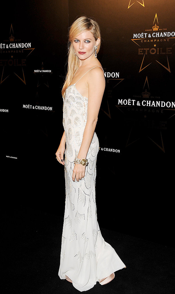 Sienna Miller wore a slinky gown and smoky eyes to the Moet & Chandon Etoile Awards and Gala.