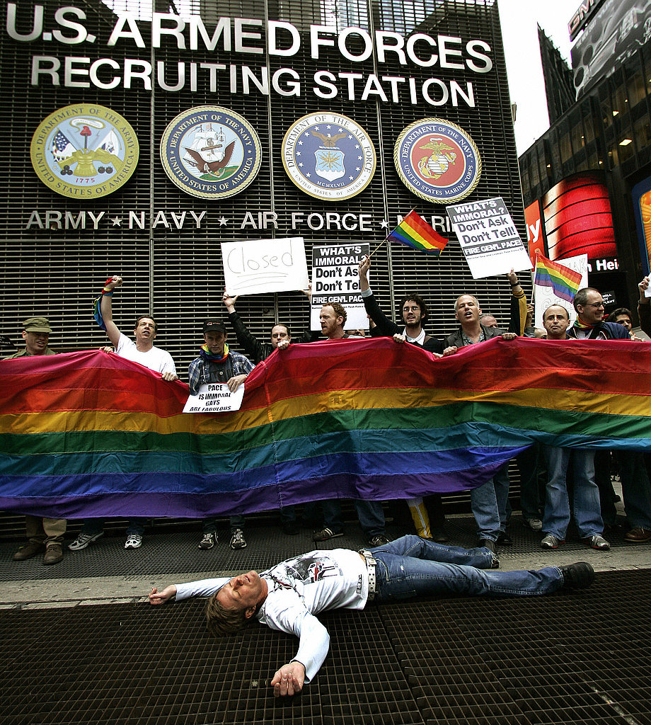 "Members of ACT UP (AIDS Coalition to Unleash Power) hold out a banner as they demonstrate in New York in 2007. The group protested at the Times Square Military Recruitment Center against the remarks made about gays by US Joint Chiefs of Staff Chairman General Peter Pace supporting ""don't ask, don't tell"" and calling homosexual acts ""immoral."""
