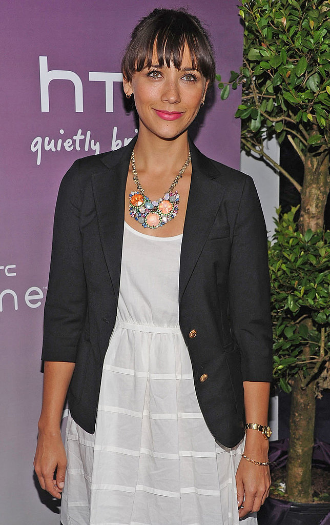 Rashida Jones adds a whimsical touch via a colorful chain and charm necklace.