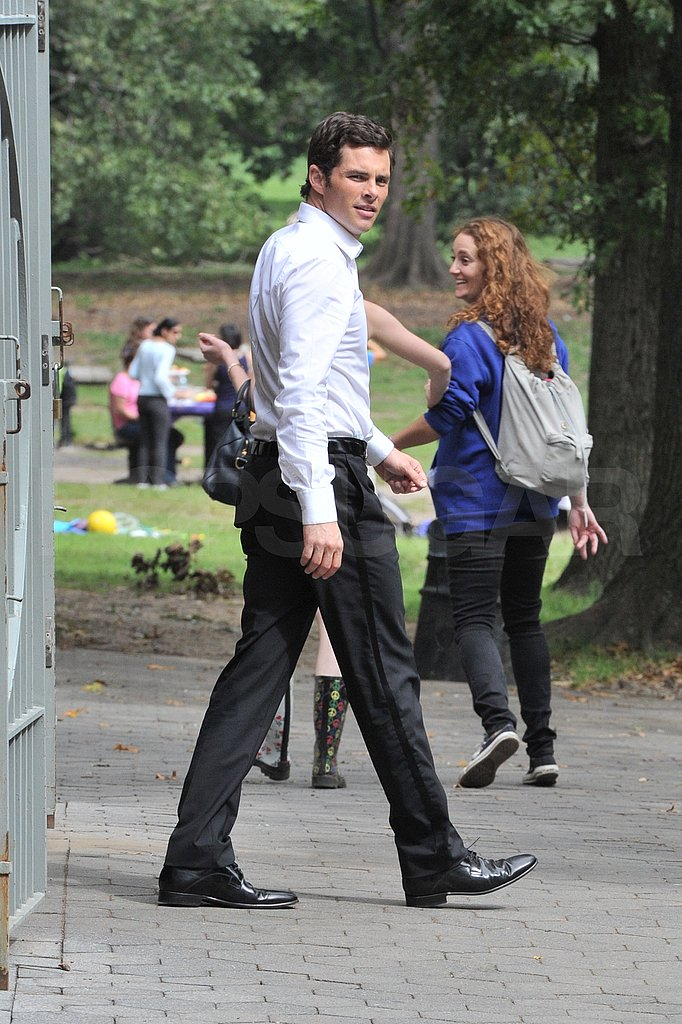 James Marsden buttoned up in a shirt and slacks on the set.