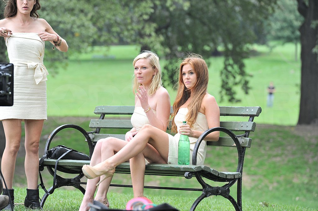 Kirsten Dunst and Isla Fisher relaxed on a park bench.