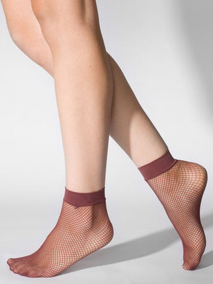 American Apparel Fishnet Sock ($8)