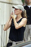Gisele Bundchen chats on her phone.
