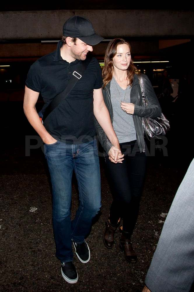 Emily Blunt and John Krasinski land at LAX.