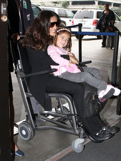 Salma Hayek and Valentina in a wheelchair at LAX.