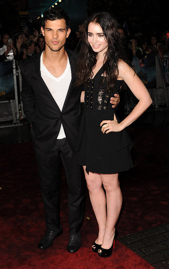 Taylor Lautner poses with Lily Collins at the Abduction premiere in London.