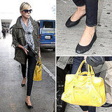 Charlize Theron Carrying a Yellow Balenciaga Bag