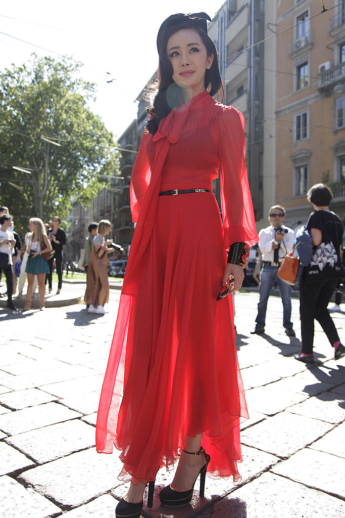 Here's a surefire way to get snapped: rock a beautifully femme dress in a fiery red hue.