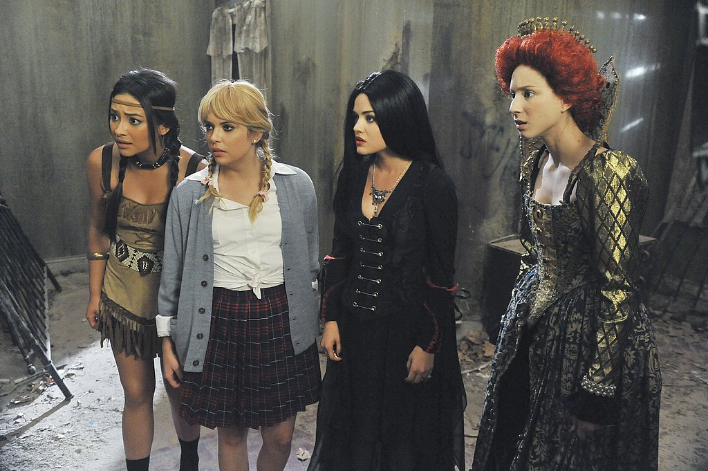 Emily goes for sexy Pocahontas, Hanna looks like she's going for early Britney Spears, Aria might be Morticia Adams, and Spencer gets regal to be a young Queen Elizabeth.