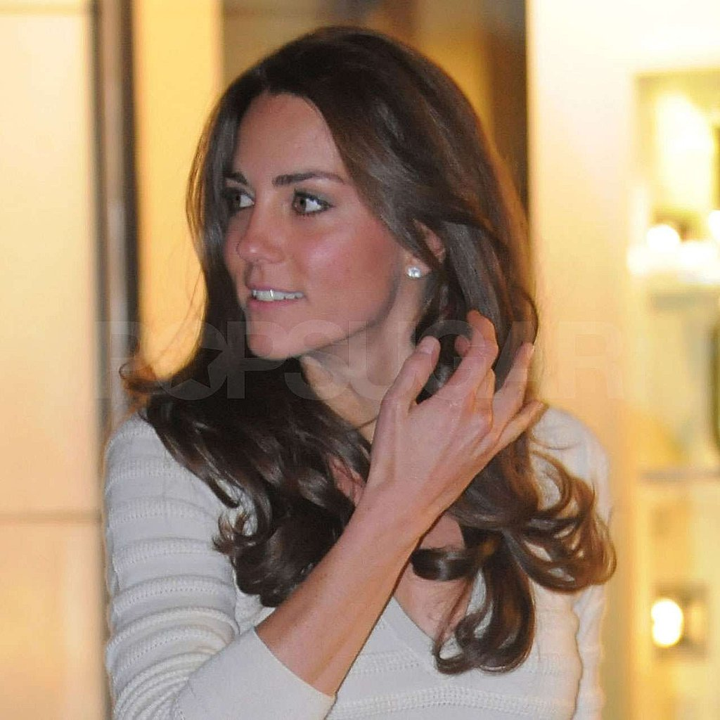 Kate Middleton tossed her hair.
