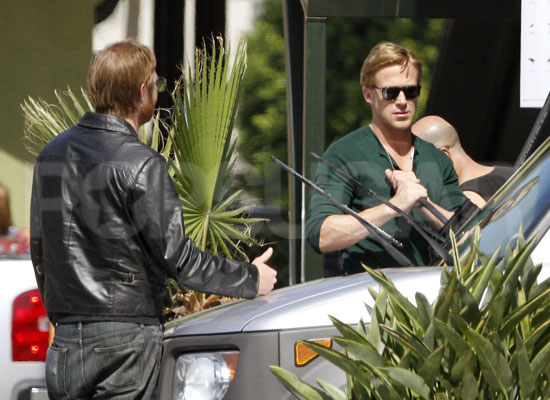 Ryan Gosling with a friend at a gas station.