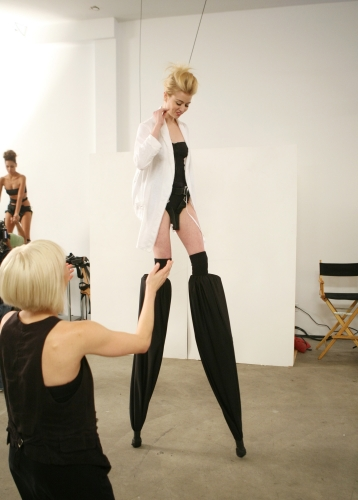 Allison tried to get her footing on her stilts before her photo shoot.  Photos courtesy of The CW