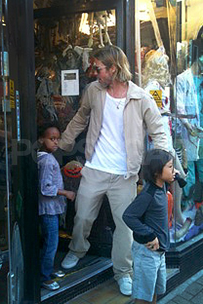 Brad Pitt helps Zahara Jolie-Pitt and Pax Jolie-Pitt on their way out of a costume shop.