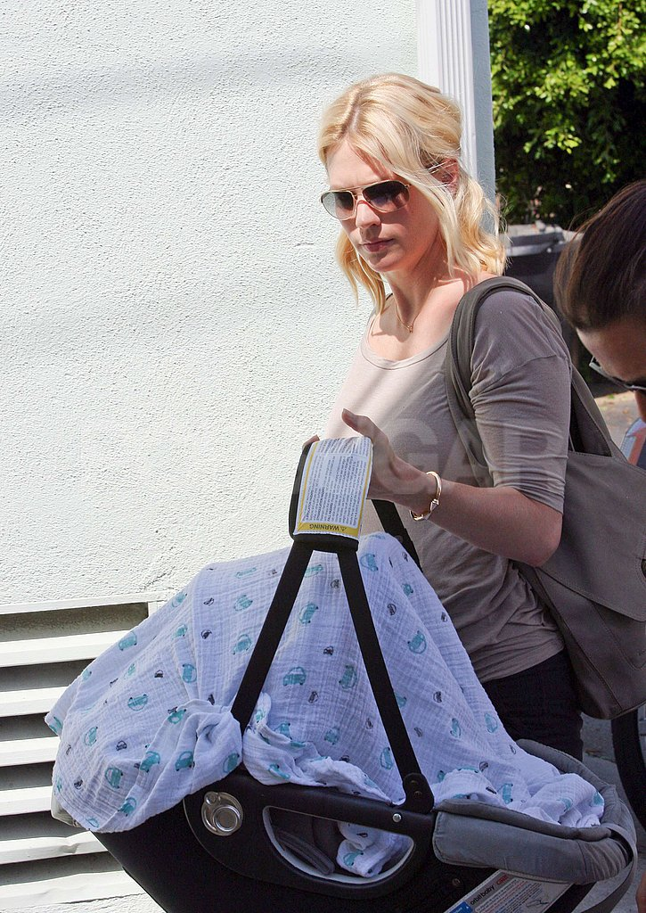 January Jones carried Xander Jones in a car seat.