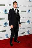 Ryan Seacrest wore a simple black suit to the 2011 Promise Gala in his honor.