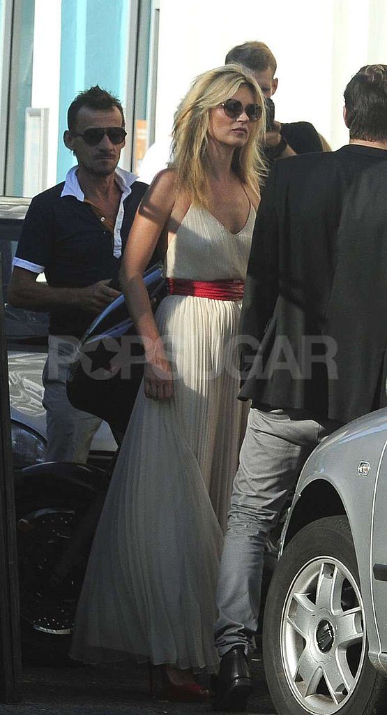 Kate Moss wore a red belt around her dress on a photo shoot in London.