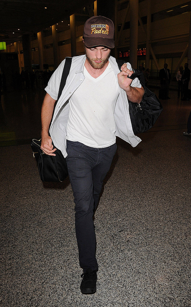 Robert Pattinson managed his own luggage at the airport.