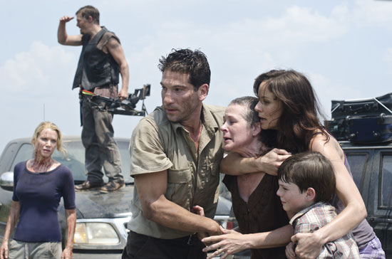 Laurie Holden as Andrea, Norman Reedus as Daryl Dixon, Jon Bernthal as Shane Walsh, Melissa Suzanne McBride as Carol, Sarah Wayne Callies as Lori Grimes, and Chandler Riggs as Carl Grimes on The Walking Dead.  Photo courtesy of AMC