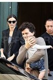 Orlando Bloom cradles his son Flynn Bloom in Paris with wife Miranda Kerr.