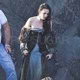 Kristen's dress was soaked with water.