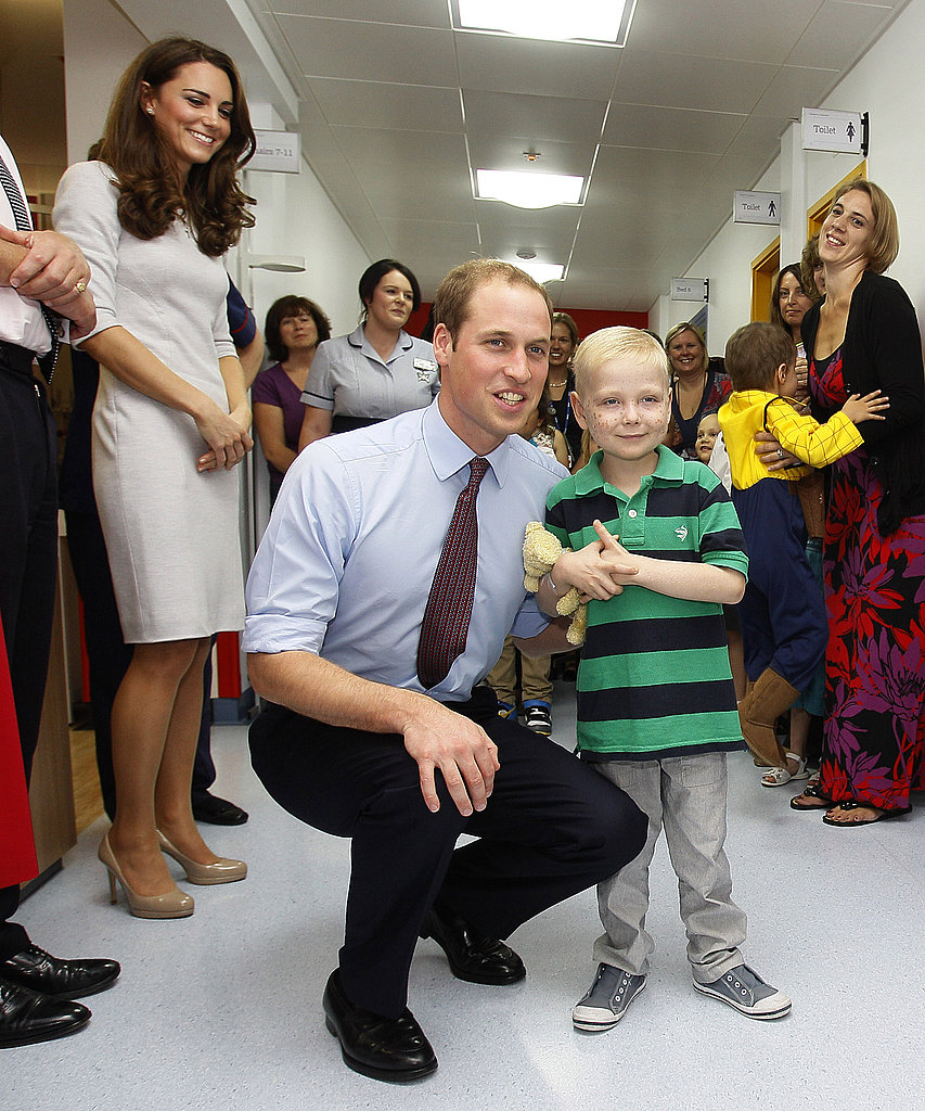 Kate Middleton looked on as Prince William talked to a little boy.