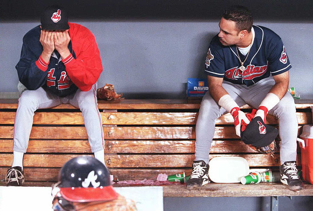 Julian Tavarez and Carlos Baerga of the Cleveland Indians sit in the dugout after their loss to the Atlanta Braves in game six of the 1995 World Series.