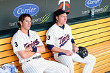 Trevor Plouffe and Luke Hughes of the Minnesota Twins make sad faces following a loss to the Cleveland Indians.