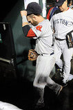 With the season over, Dustin Pedroia of the Boston Red Sox walks into the locker room.