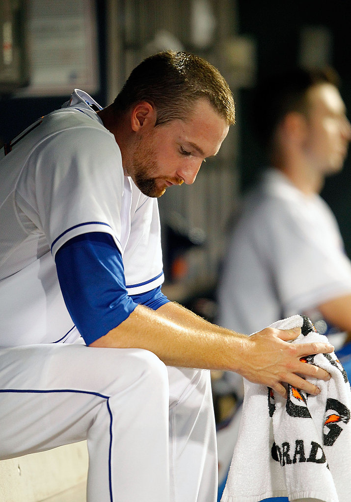 Bobby Parnell of the New York Mets sits depressed in the dugout.