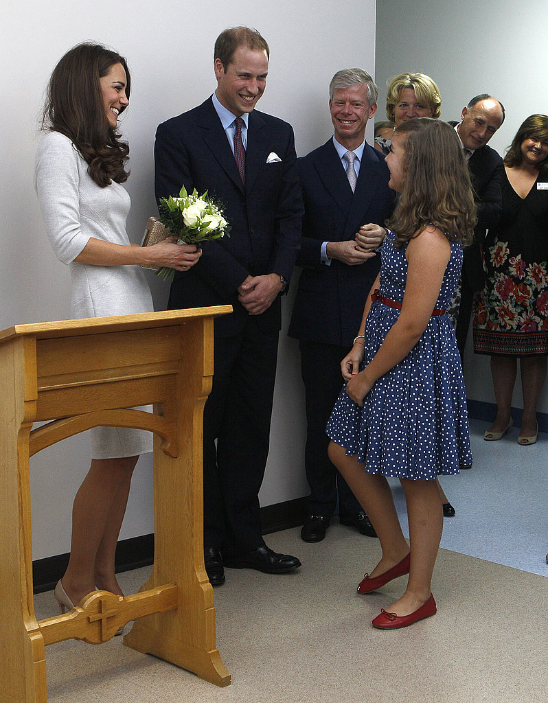 Will and Kate laugh with a girl at the hospital.