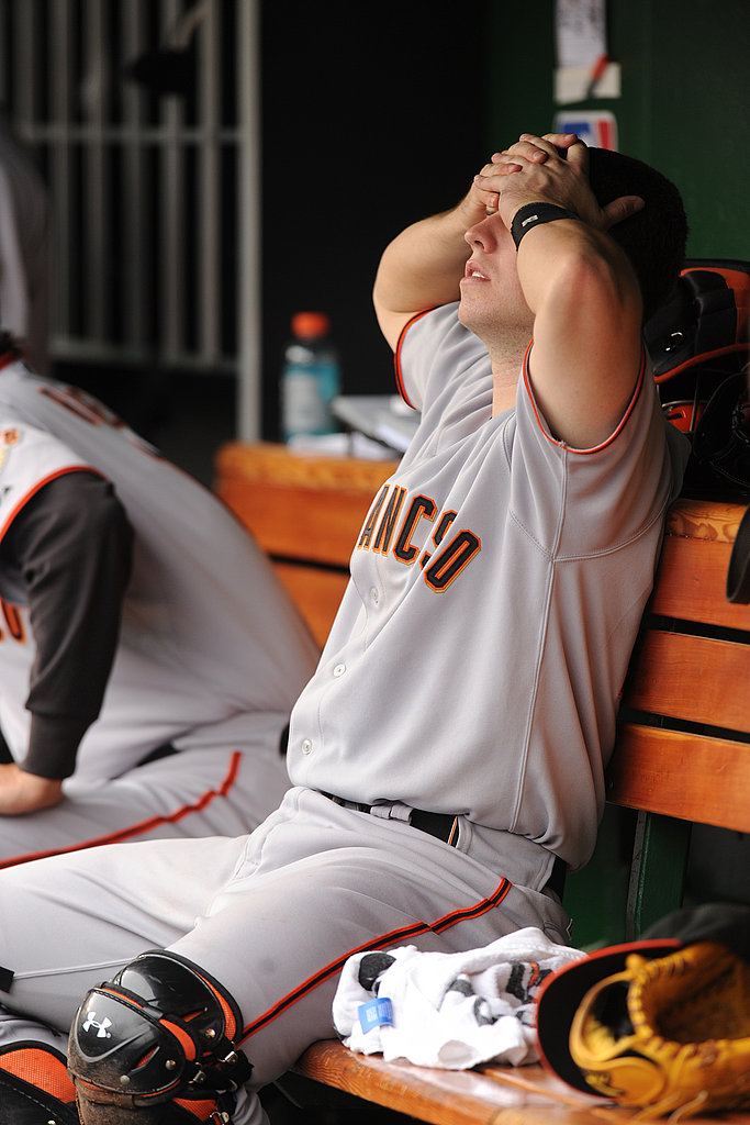 Cutie Giants catcher Buster Posey hides his eyes during a May game. After winning the World Series last year, the Giants failed to make the playoffs, and Buster sat out most of the season with an injury.