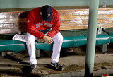 Alfredo Aceves hangs his head in the dugout.