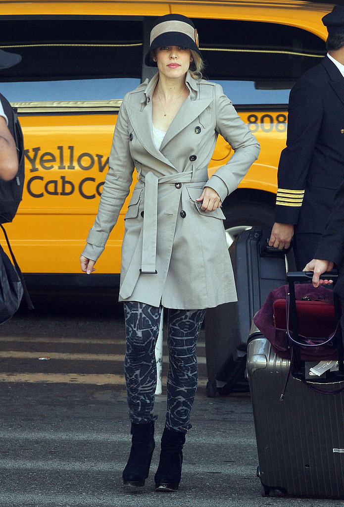 Rachel McAdams covered up in a trench coat.