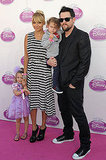 Nicole Richie, Joel Madden, Harlow Madden, and Sparrow Madden at a Disney event.