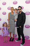 Nicole Richie and Joel Madden take Sparrow and Harlow to Disney's Princess Royal Court Celebration.
