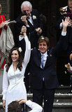 Paul McCartney and Nancy Shevell raised their hands to celebrate their marriage.