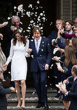 Nancy Shevell and Paul McCartney were showered with flower petals in London.