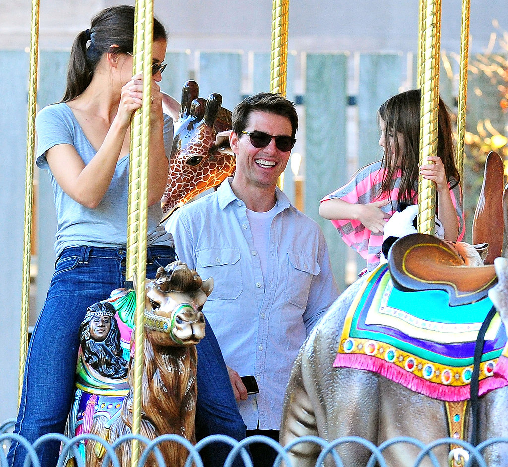 Katie Holmes and Suri Cruise both looked back at Tom Cruise on a carousel.
