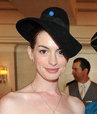 Anne Hathaway wore a black hat.