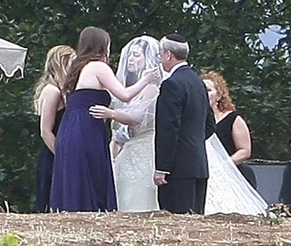 Lauren greeted her bridesmaids at the end of the aisle.