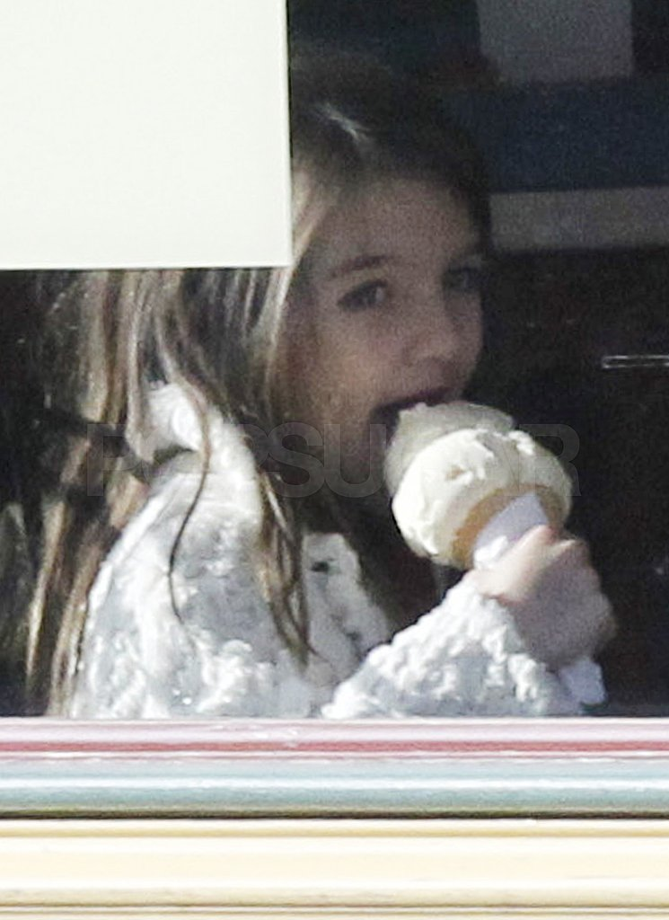 Suri Cruise ate a big ice cream cone.