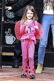 Suri Cruise carrying a wand.