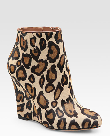 Comfy and cool wedge boots.  Wilma Leopard-Print Calf Hair Ankle Boots ($160)